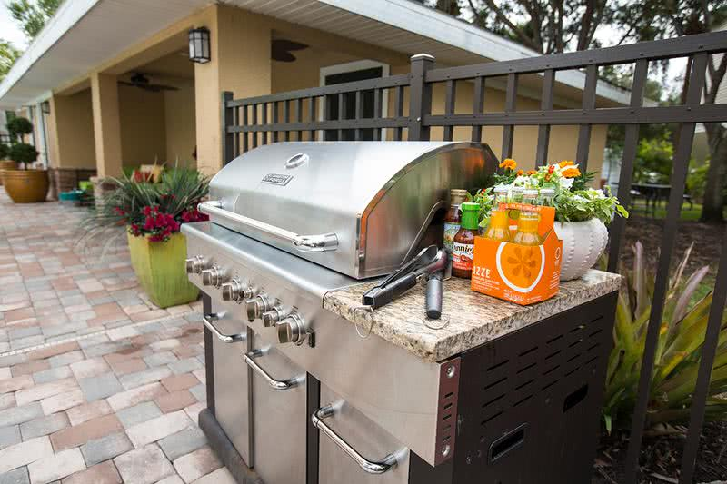 Gas Grill | Have a cookout with some friends next to the pool with our gas grill.
