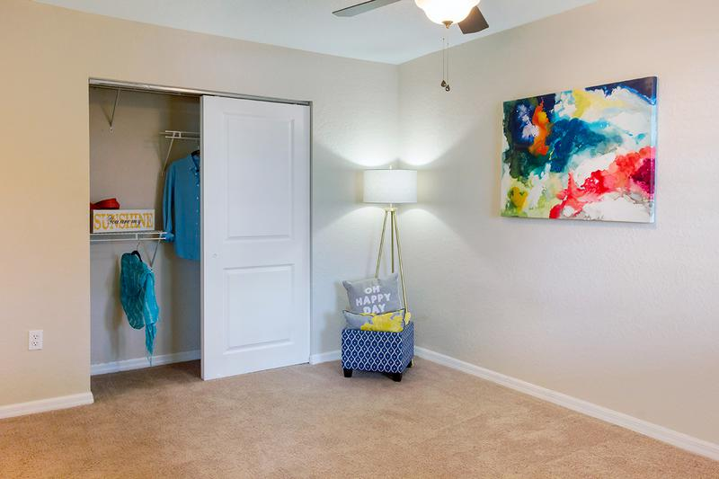 Guest Bedroom | Spacious guest bedroom featuring a large closet and ceiling fan.