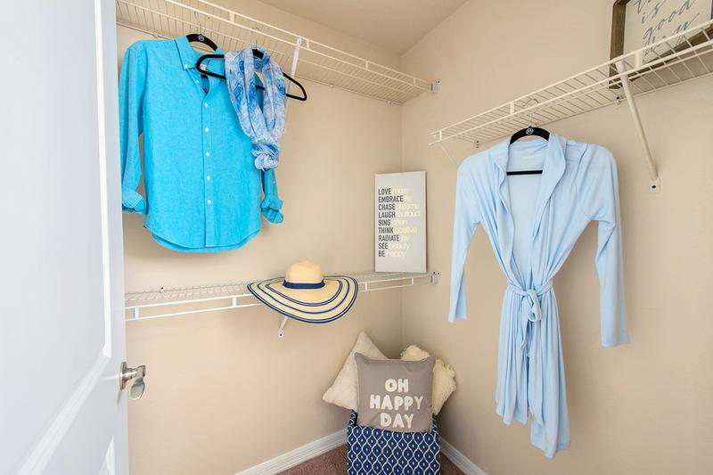 Walk-In Closet | Spacious walk-in closet in the master bedrooms featuring built-in organizers.