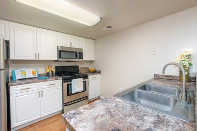 Kitchen | Upgraded kitchens, fully equipped with stainless steel appliances and a laundry room.