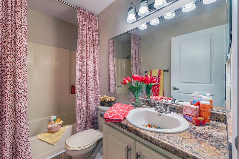 Bathroom | Spacious, newly renovated bathrooms featuring new countertops and cabinetry.