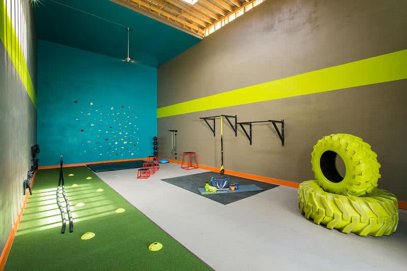 X-Fit Gym | Get an invigorating workout in our X-Fit area - complete with TRX suspension equipment, tires, battle ropes, and more.
