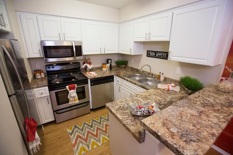Newly Remodeled Kitchen | Designer kitchen with new granite style counter tops and beautiful cabinetry so you can cook in style.