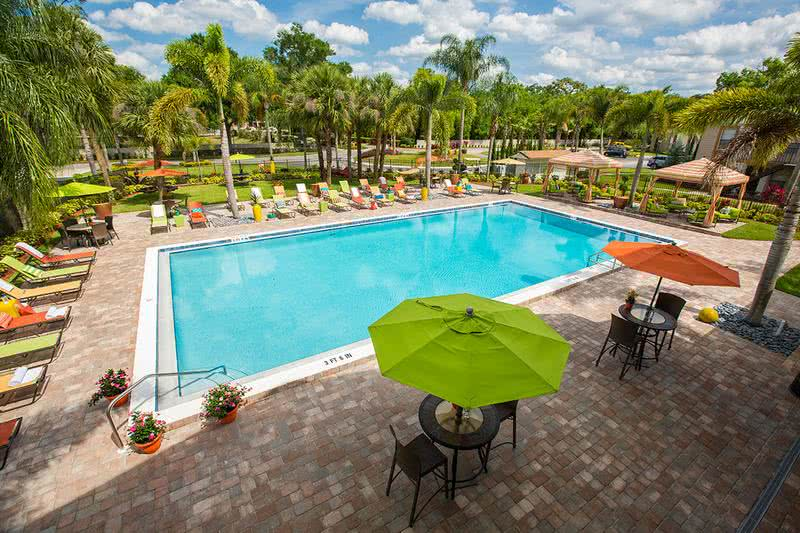 Resort-Style Swimming Pool | Resort style pool with cabanas and poolside Wi-Fi. Our residents will enjoy many relaxing days in a beautiful setting with tropical landscaping.