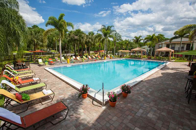 Sparkling Swimming Pool | Resort style pool with cabanas and poolside Wi-Fi. Our residents will enjoy many relaxing days in a beautiful setting with tropical landscaping.