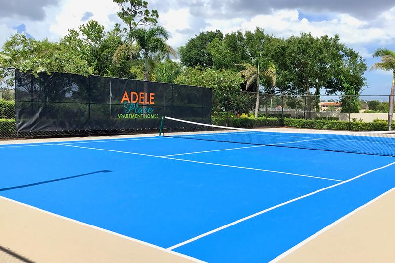 Tennis Court | Enjoy some fun in the sun while playing a game of tennis here at Adele Place.
