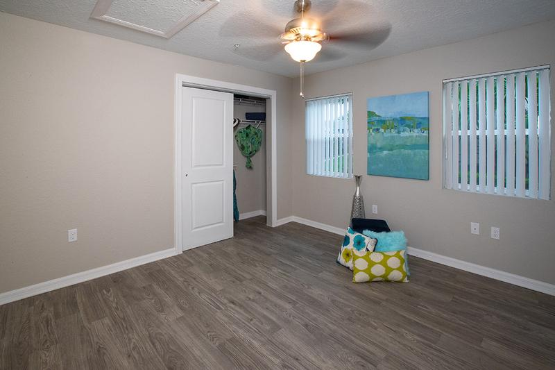 Bedroom | Spacious bedrooms featuring a multi-speed ceiling fan and a spacious closet.