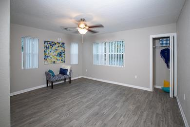 Spacious Living Room | Your spacious living room features either hardwood style flooring or plush carpeting, a ceiling fan, and a storage closet.