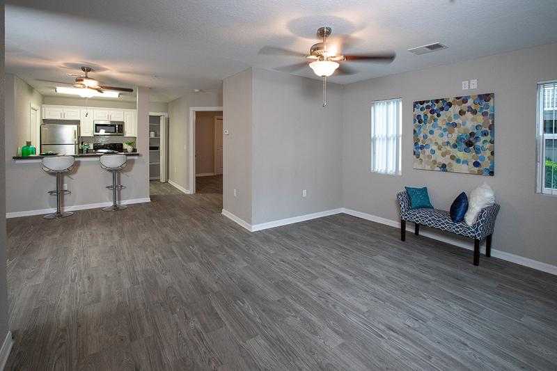 Open Floor Plans | Your spacious living room opens up into the kitchen.