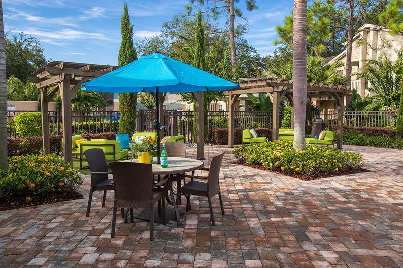 Tables with Umbrellas | Our sundeck offers plenty of tables with umbrellas.