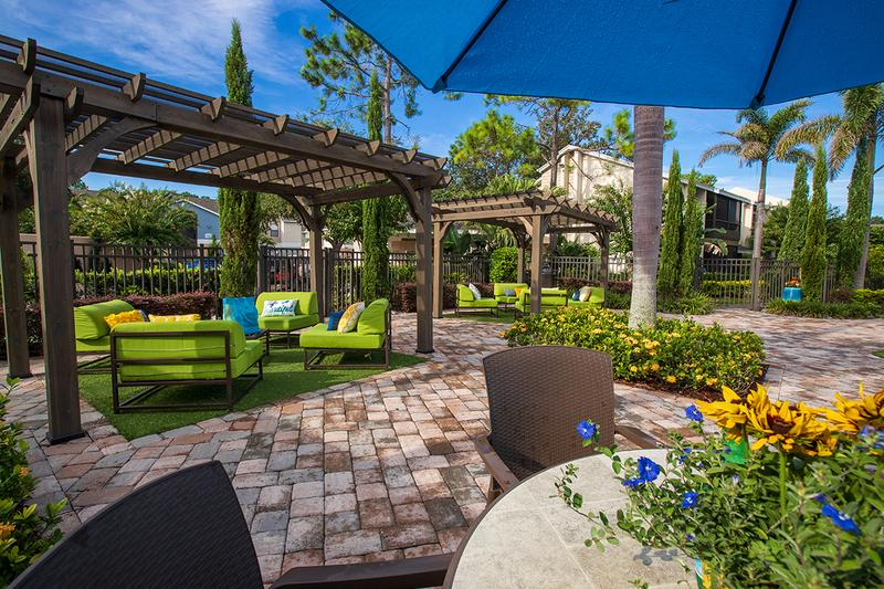 Poolside Tables & Pergolas | Sit at one of our poolside tables with umbrellas or under one of our pergolas.
