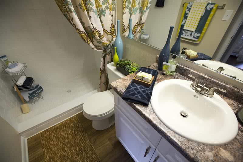 Bathroom | Stylish new bathrooms with updated counter tops and cabinetry and brush nickel fixtures.