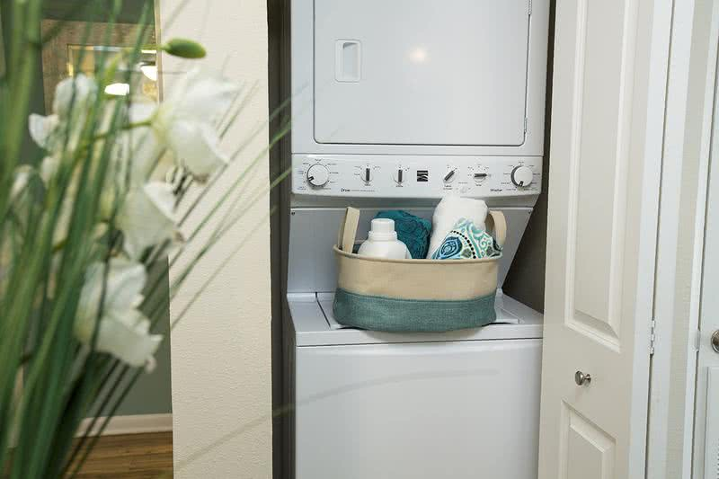 Laundry Room | Enjoy your own full size washer/dryer with extra storage. (In select apartments)