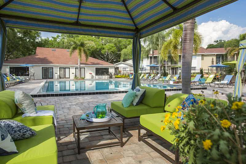 Cabana Seating | Overlook our beautiful resort-style pool  from under our cabana.