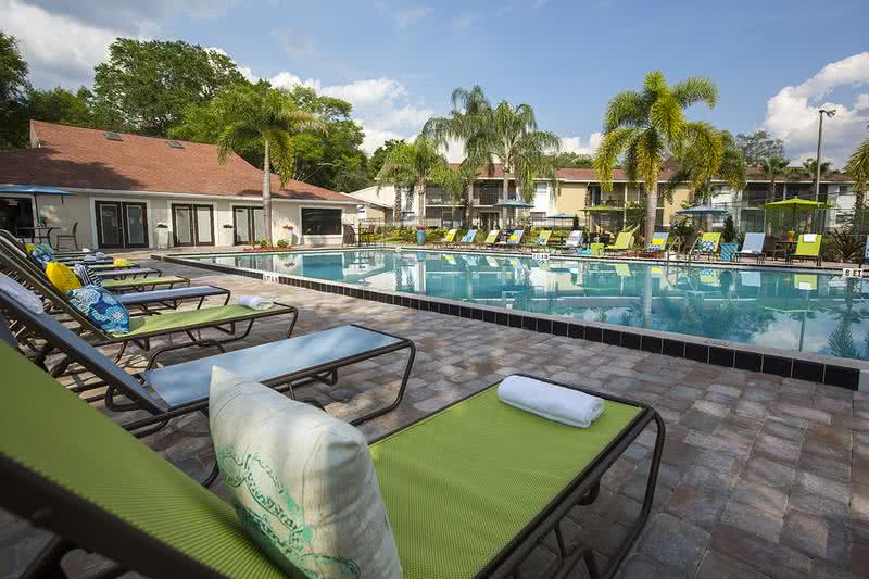 Resort-Style Pool | Relaxation swimming pool with lounge chairs and picnic tables.