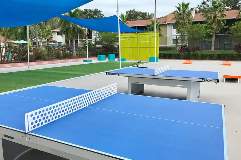 Ping Pong & Corn Hole | Enjoy a game of ping pong or corn hole at our outdoor sports court.