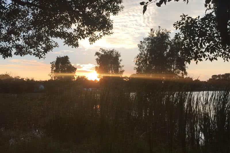 Sunset at Lake Lockhart | Watch the beautiful sunset over Lake Lockhart as you relax in one of our lakeside hammocks.