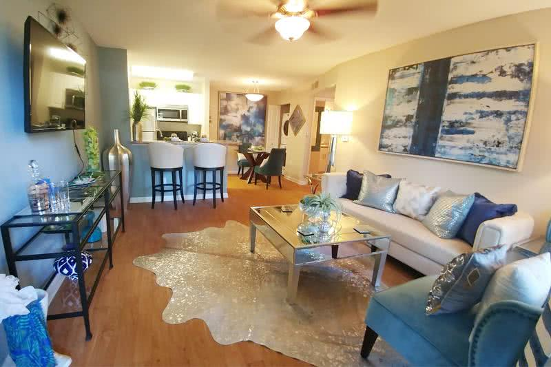 Living & Dining Room | Your open floor plan layout also features a separate dining area and breakfast bar off of the kitchen.