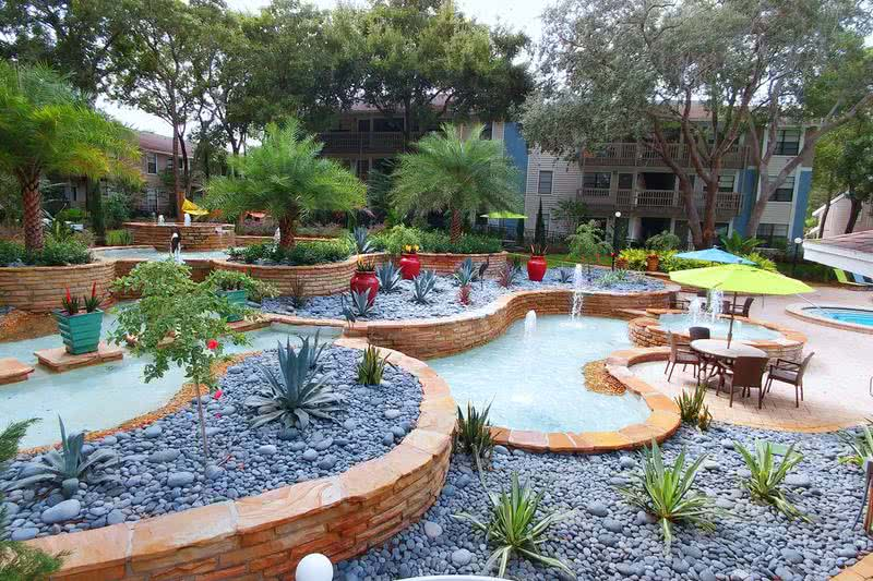 Lush Landscaping | Beautiful, lush landscaping and fountains surrounds the pool area.