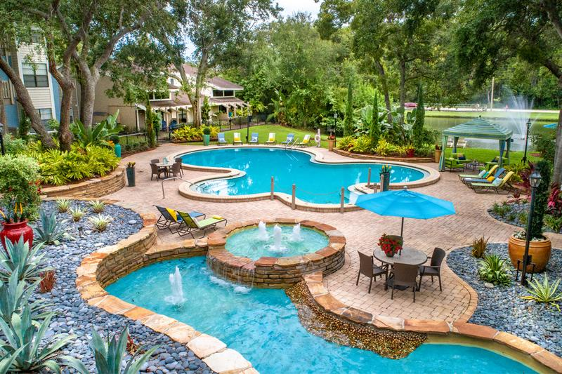 Pool Area | Beautiful, lush landscaping and fountains surrounds the pool area.