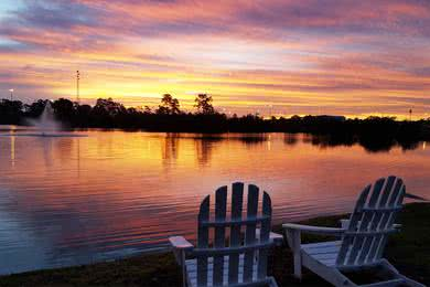 Lake Views | Enjoy watching the sunset over the lake from one of our Adirondack chairs overlooking the lake.
