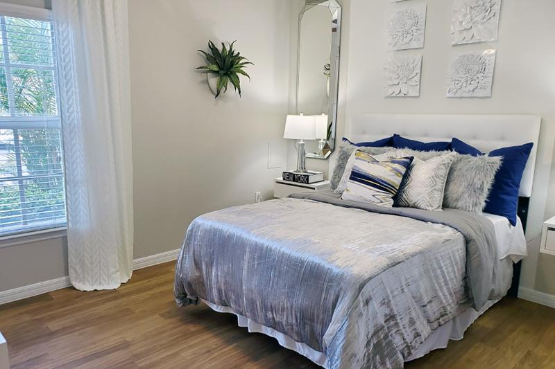 Guest Bedroom | Spacious bedrooms featuring large windows and plush, neutral carpeting, and ample closet space.