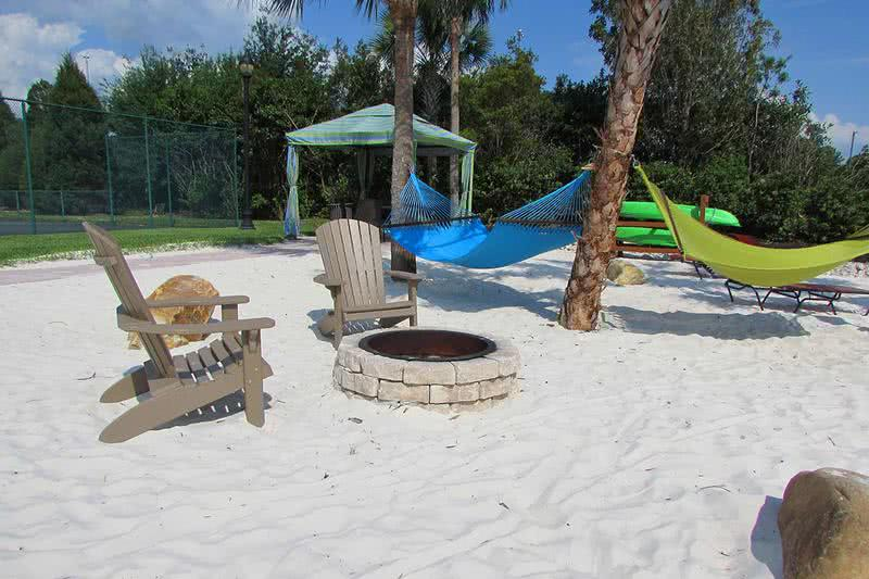 Outdoor Firepit | Enjoy a fire at our outdoor fire pit on our beach area next to the hammock garden.