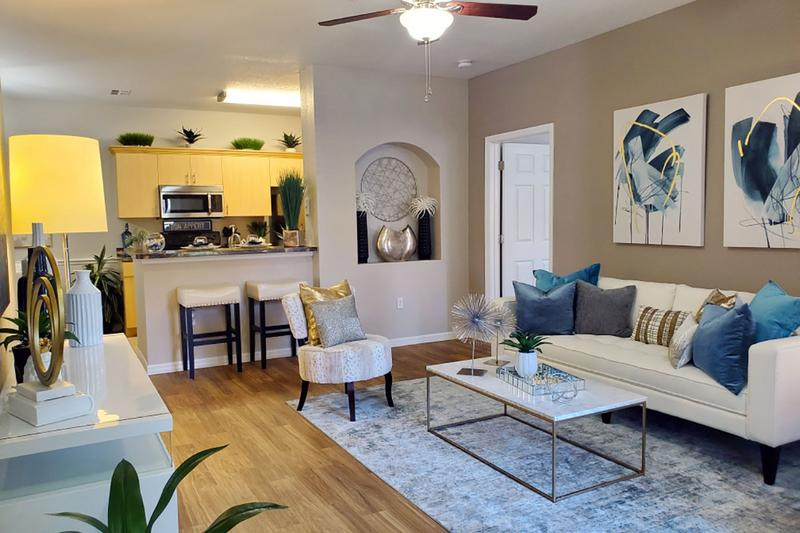 Largest Floor Plans in the Area | You'll love our open floor plan concepts including spacious living rooms with wood-style flooring and a ceiling fan.