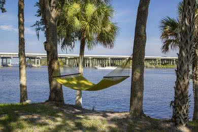 Boat Dock | Enjoy our lakeside hammocks and boat dock access.