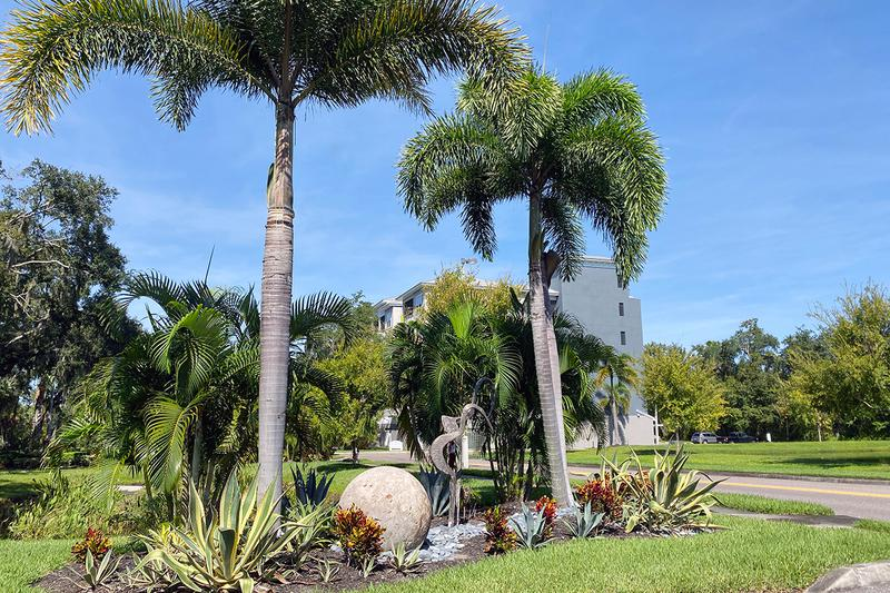 Tropical Landscaping | You'll enjoy the beautifully landscaped grounds with sculptures.