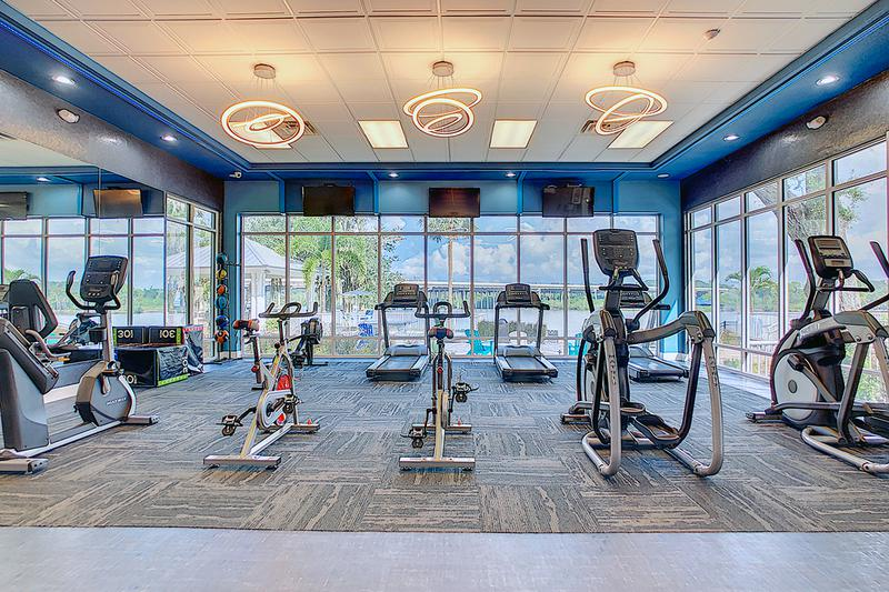 Newly Renovated Fitness Center | Work out in our newly renovated fitness center featuring a view of our beautiful lake.