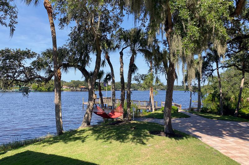 Waterfront Living | Enjoy our lakeside hammocks and boat dock access.