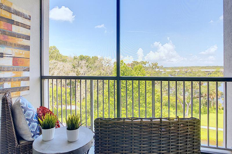 Beautiful Views | Enjoy the outdoors with a view from the privacy of your very own screened-in patio.