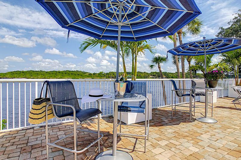 Fantastic Riverfront Views | Have a seat under our shaded tables featuring umbrellas.