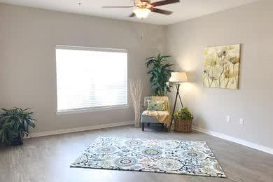 Ceiling Fans | Spacious bedrooms featuring a ceiling fan and wood-style flooring.