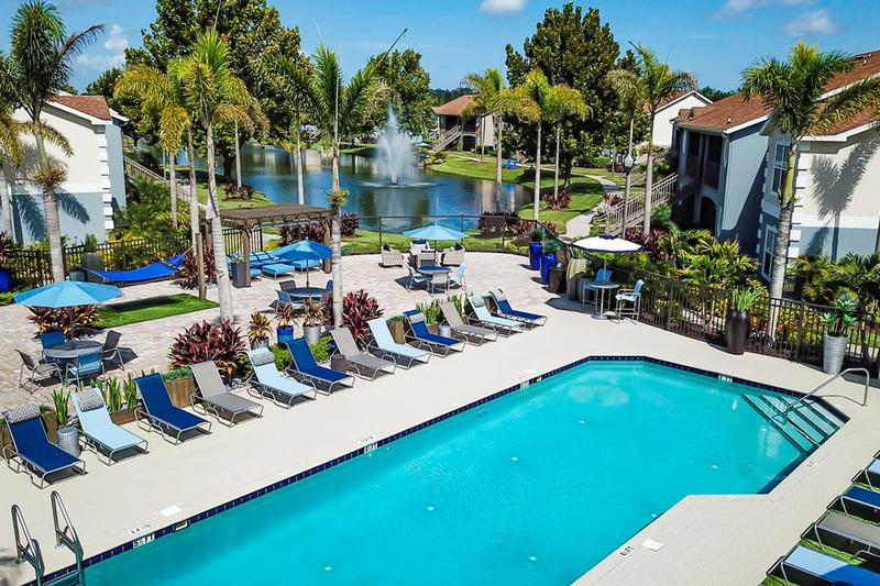 Pool Area | Our expansive sundeck/pool area includes plenty of loungers, tables with umbrellas, and other seating.