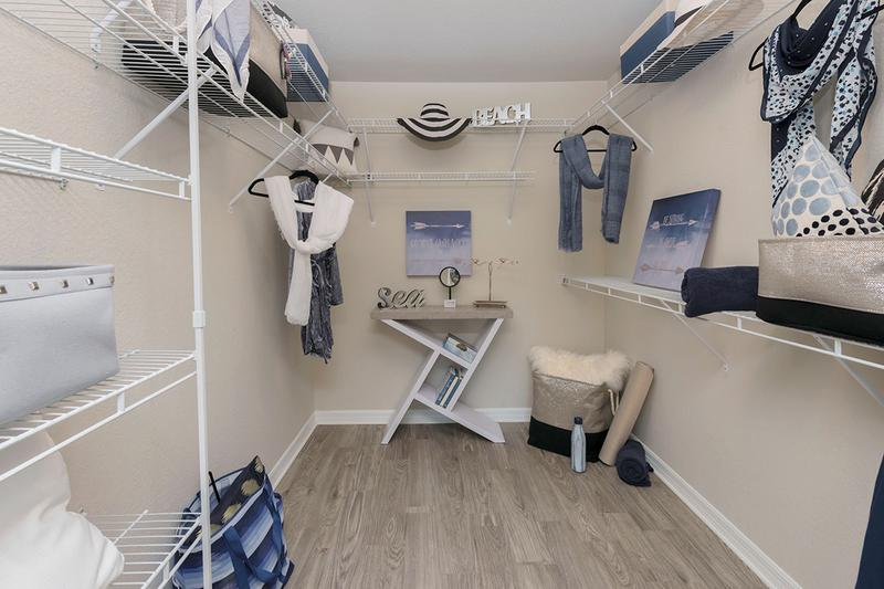 Walk-In Closets | Walk-in closets featuring built-in organizers.
