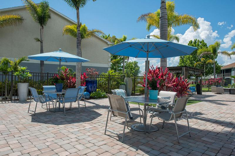 Poolside Tables | Our expansive sundeck features plenty of tables with umbrellas.