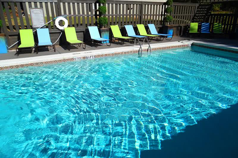 Sparkling Swimming Pool | Take a dip in our sparkling swimming pool or relax on our expansive sundeck.