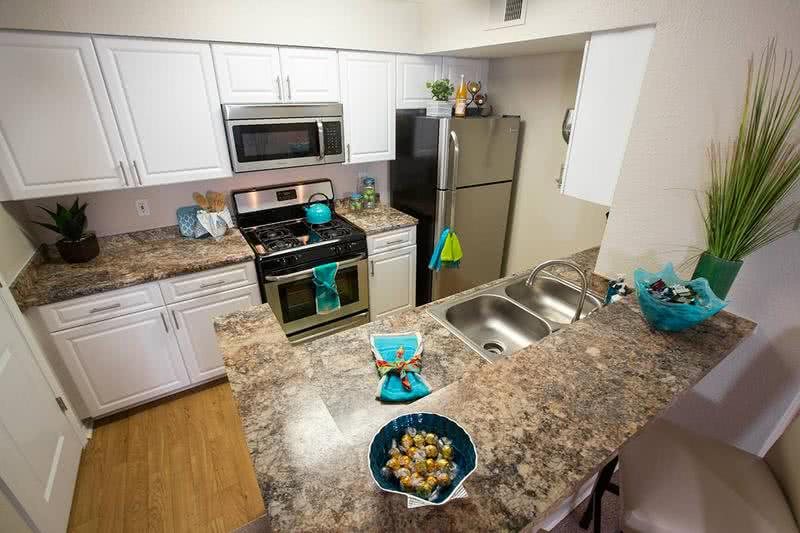 Kitchen | Newly remodeled kitchens featuring updated counter tops and cabinets.
