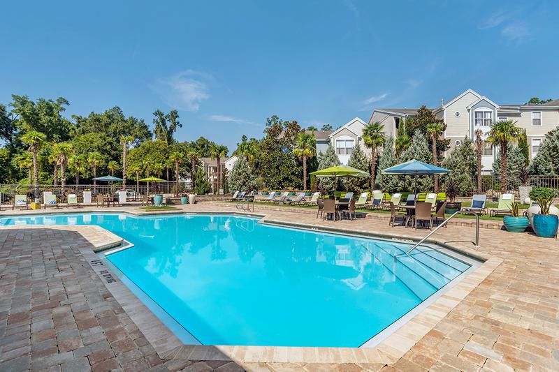 Resort Style Swimming Pool | Sparkling resort-style swimming pool with expansive sundeck featuring plenty of loungers for you to take in the Florida sun!