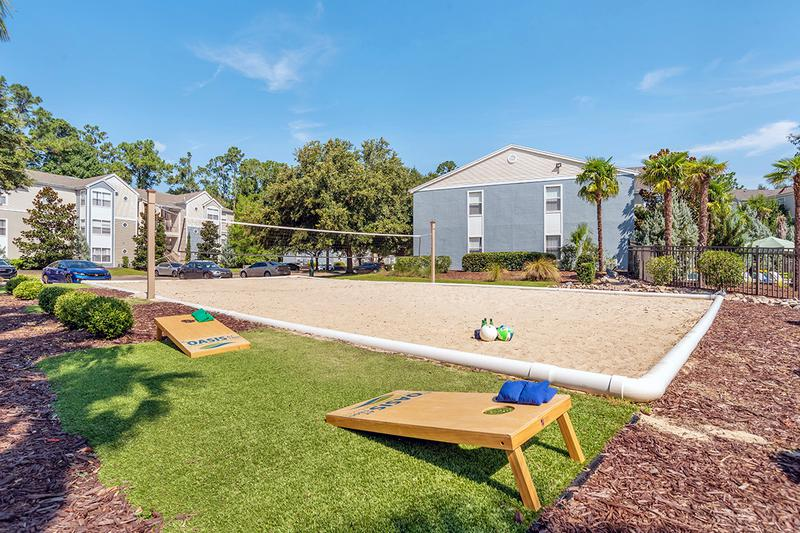 Sand Volleyball Court | Have fun in the sun at our on-site volleyball court or play a game of corn hole.