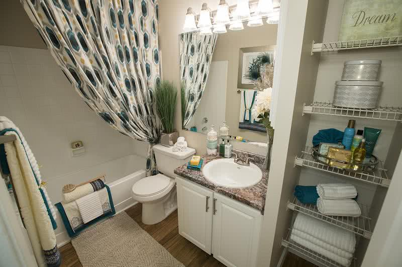 Updated Bathrooms | Newly remodeled bathrooms featuring granite-style counter tops, wood-style flooring, and large mirrors.