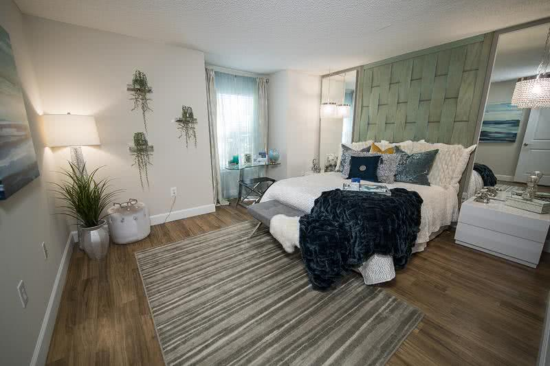 Master Bedroom | Spacious bedrooms featuring walk-in closets and wood-style flooring.