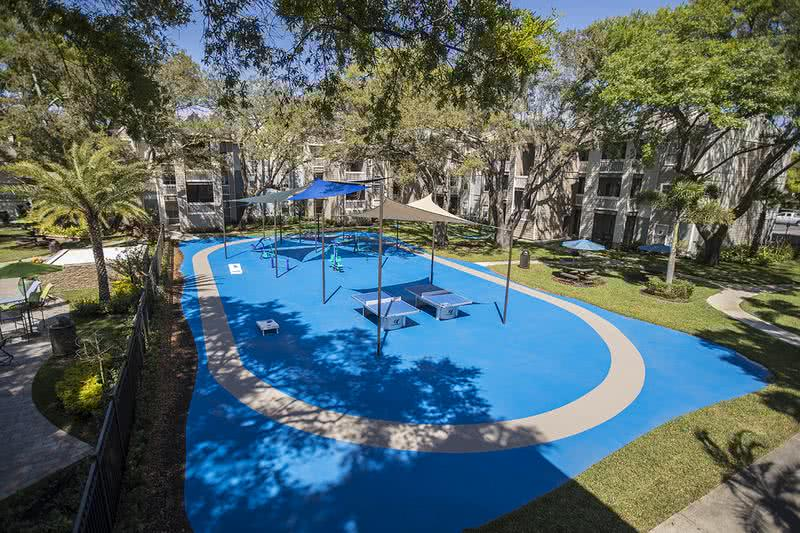 Outdoor Gym/Sports Court | Get a workout and have some fun at our outdoor sports court including ping pong tables and exercise equipment.