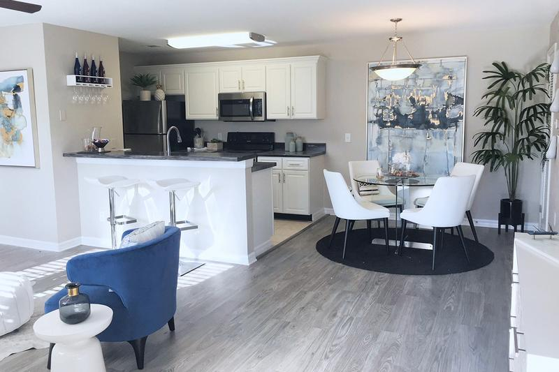 Separate Dining Area | You'll absolutely love having a separate dining area that opens up to the kitchen and living areas - perfect for entertaining!