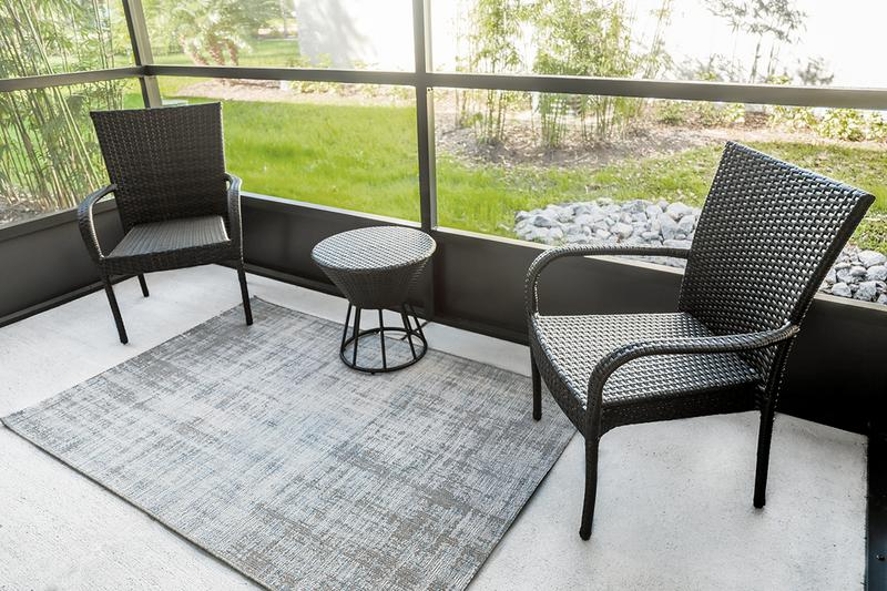 Screened-In Patio | Enjoy the outdoors from the privacy of your very own private patio.
