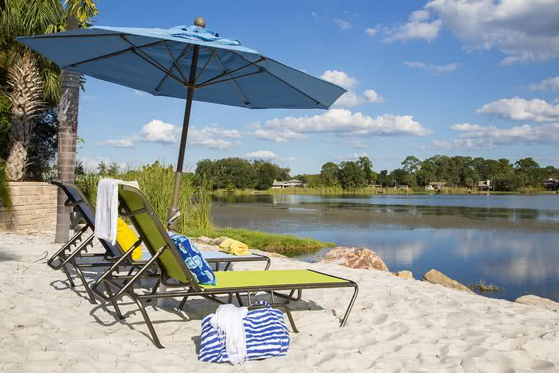 Lakefront Beach Area | Relax with your toes in the sand at our private lakefront beach area with dock.