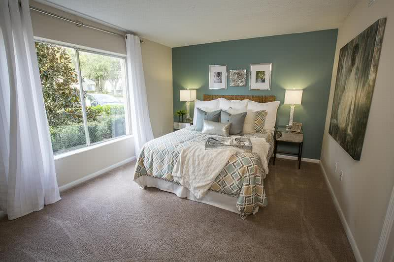 Bedroom | Bedrooms feature enormous picture windows with ample closet space. (Regatta)