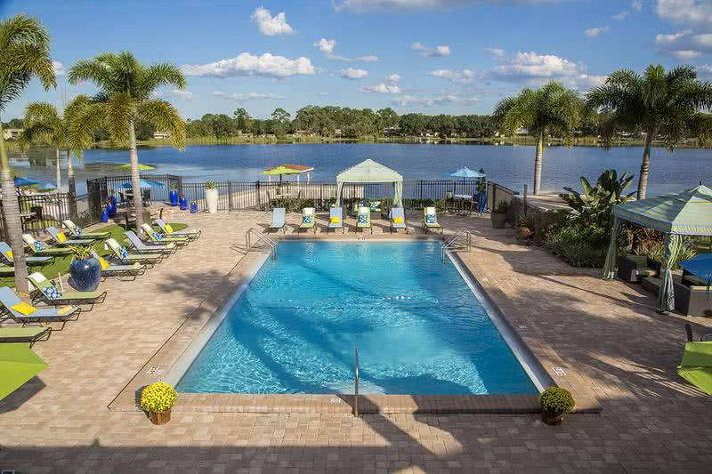 Lakeside Pool | Lakeside resort-style pool with cabanas and Wi-Fi. It's is a great day for a stay cation!